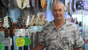 Ashley Hawken says sales have slowed at his music store.