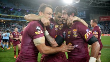 Will Chambers (left) celebrates a Maroons Origin victory with former Storm teammate Greg Inglis (centre) and Johnathan Thurston.