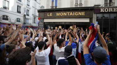 French fans react as they watch the final in a Parisian cafe.