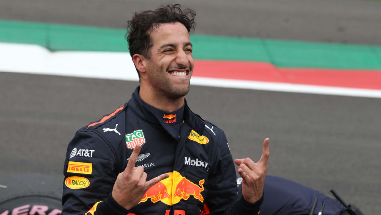 Rock star: Daniel Ricciardo rejoices after securing a rare pole position for himself and Red Bull.