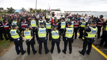 Police stand between far-right and anti-racism protesters at a rally in Melbourne in January this year.