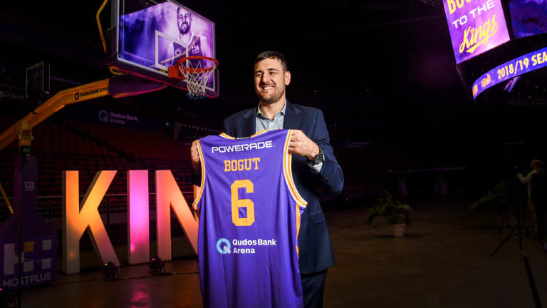 Star power: Andrew Bogut unveils his No.6 jersey after signing for the Sydney Kings.