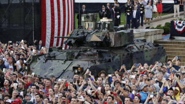 A Bradley Fighting Vehicle and audience members during an Independence Day celebration in front of the Lincoln Memorial.
