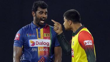 Blow-up: Sri Lanka's Thisara Perera and Bangladesh substitute Nurul Hasan in a heated spat.