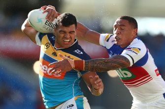 GOLD COAST, AUSTRALIA - APRIL 10: David Fifita of the Titans is tackled by Tyson Frizell of the Knights during the round five NRL match between the Gold Coast Titans and the Newcastle Knights at Cbus Super Stadium, on April 10, 2021, in Gold Coast, Australia. (Photo by Chris Hyde/Getty Images)