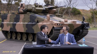 Trade Minister Martin Pakula and Hanwha Australia managing director Richard Cho in front of Hanwha's Redback vehicle on Tuesday.
