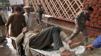 Bombing at mosque kills scores in Afghanistan