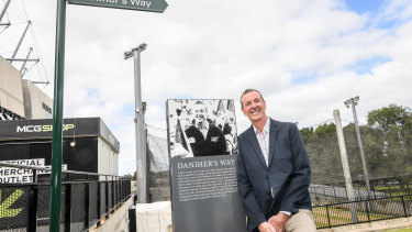 Neale Daniher poses next to the sign marking Daniher's Way.