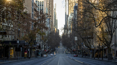 An empty Collins St in Melbourne. The stage four lockdown includes a citywide curfew from 8pm-5am.