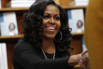 Picture of resilience, Michelle Obama, greets a supporter.