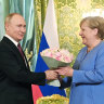 Despite flower offering, Merkel, Putin clash over Navalny on her last trip to Russia