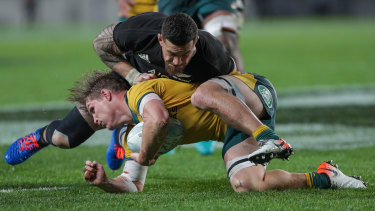 Sonny Bill Williams crunches Wallabies skipper Michael Hooper.