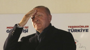 Turkey's President and ruling Justice and Development Party, or AKP, leader Recep Tayyip Erdogan greets supporters after the results of the local elections were announced in Ankara.