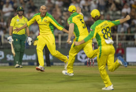 Ashton Agar celebrates with teammates after dismissing South Africa's Dale Steyn in February.
