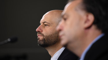 ARLC chairman Peter V'landys and NRL CEO Todd Greenberg are battling to save the season.