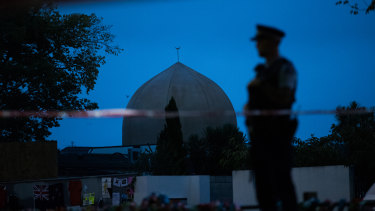 A policeman stands guard at the Al Noor Mosque ahead of a national call to prayer.