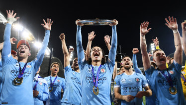 Stefan Colakovski of Melbourne City celebrates victory with teammates and holds aloft the A-League trophy after the grand final between Melbourne City and Sydney FC at AAMI Park.