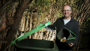 Glen Eira mayor Jamie Hyams putting out food scraps in the green waste bin for kerbside collection.