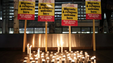 Signs and candles on a wall were placed at a vigil for the 39 lorry victims, outside the Home Office in London.