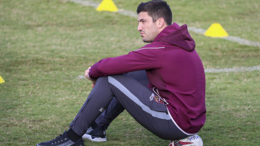 Matt Gillett was relegated to spectator at Queensland training on Sunday as he races to be fit for Origin III.