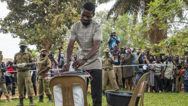 Bobi Wine votes in Kampala in a presidential election tainted by widespread violence.