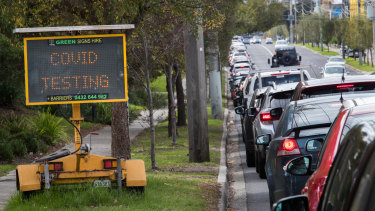 A long line of cars waiting to enter a COVID-19 testing site in suburban Maidstone on Tuesday.