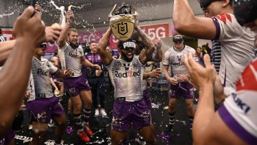 Melbourne Storm celebrate their 2020 Grand Final victory.