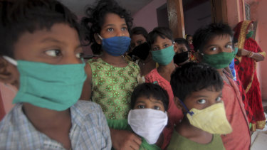 Evacuated children wear masks as a precaution against the spread of coronavirus as cyclone Amphan moved towards India in May.