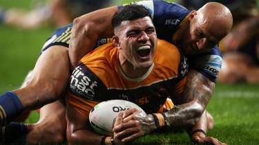 David Fifita crashes over for Brisbane's first try before being injured in the second half.