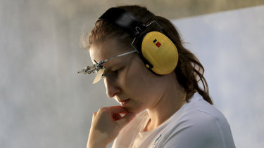 Elena Galiabovitch takes a moment to gather her thoughts during the 25m pistol event at the Rio Olympics.