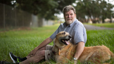 Michael Higgins, who has been diagnosed with bowel cancer, with his dog Alex.