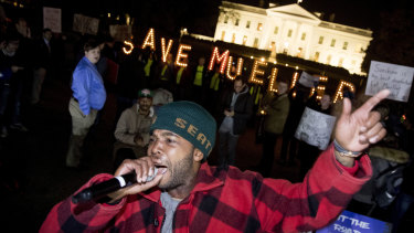 """Protesters in front of the White House in Washington as part of a nationwide """"Protect Mueller"""" campaign."""
