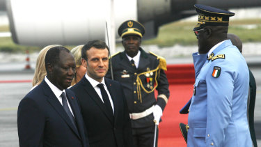 French President Emmanuel Macron is welcomed by Ivory Coast President Alassane Ouattara upon arrival in Abidjan at the weekend.