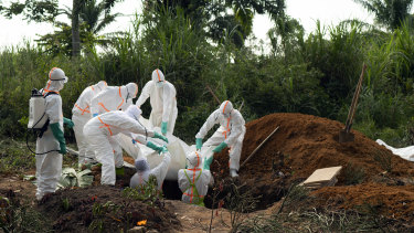 An Ebola victim is put to rest at the Muslim cemetery in Beni, Democratic Republic of Congo.