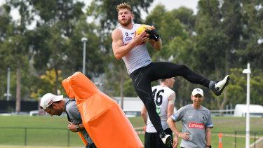 Taylor Adams flies at training on Thursday.