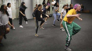 Children run through K-Pop dance moves under the instruction of choreographer David Ward at the Korean Cultural Centre.