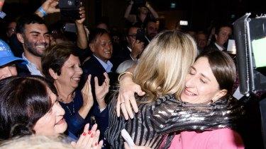 Gladys Berejiklian hugs her sister Mary.