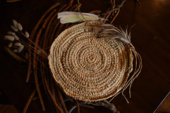 One of the woven grass baskets.