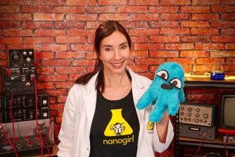 New Zealand scientist Dr Michelle Dickinson, aka Nanogirl, with a coronavirus stuffed toy.