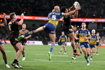 David Nofoaluma and Blake Ferguson battle for a high ball.