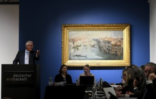Auctioneer Roger McIlroy with Arthur Streeton's painting The Grand Canal, 1908, auctioned at Deutscher and Hackett in Melbourne.