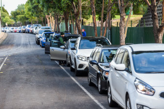 Melburnians line up for drive-in testing in the city's north-west.