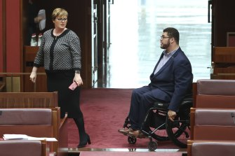 Minister for the NDIS Linda Reynolds and Greens senator Jordon Steele-John during a debate in Parliament.