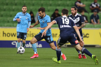 Sydney's Kosta Barbarouses looks to control the ball against Victory.