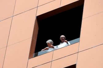 Quarantined hotel guests on the balcony of the Peppers Waymouth Adelaide hotel on Wednesday