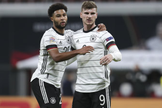 Timo Werner (right) celebrates with German teammate Serge Gnabry.