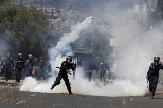 Police throw tear gas at protesters in Honduras.