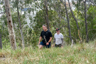Officers from the missing persons unit search Darebin Creek Reserve on Thursday.
