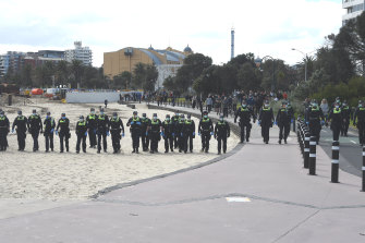Police on the beach at St Kilda on Saturday.