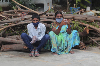 People wait to be tested for COVID-19 in Hyderabad, India, on Tuesday.